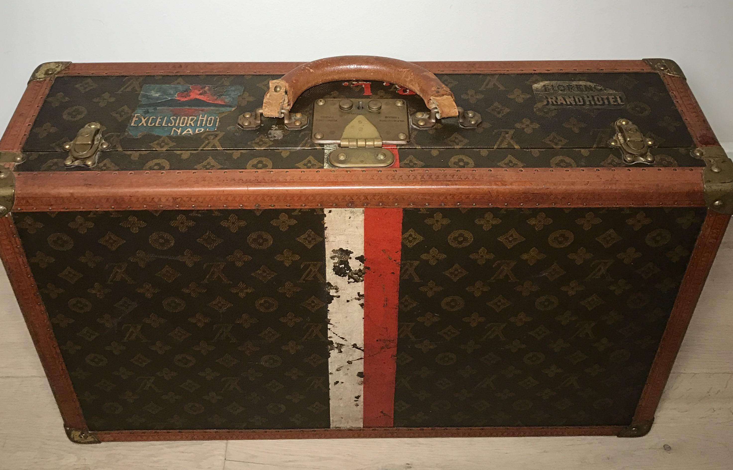 d329c490982f Antique Louis Vuitton suitcase red white stripe - Pinth Vintage Luggage